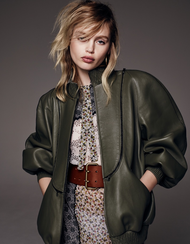 Staz models Fendi leather jacket with brown belt and floral print dress