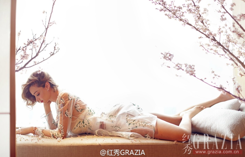 Miranda Kerr lounges in style for the fashion spread