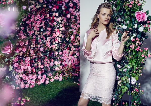 Looking pretty in pink, Anna Jagodzinska wears a pink bomber jacket with a lace skirt