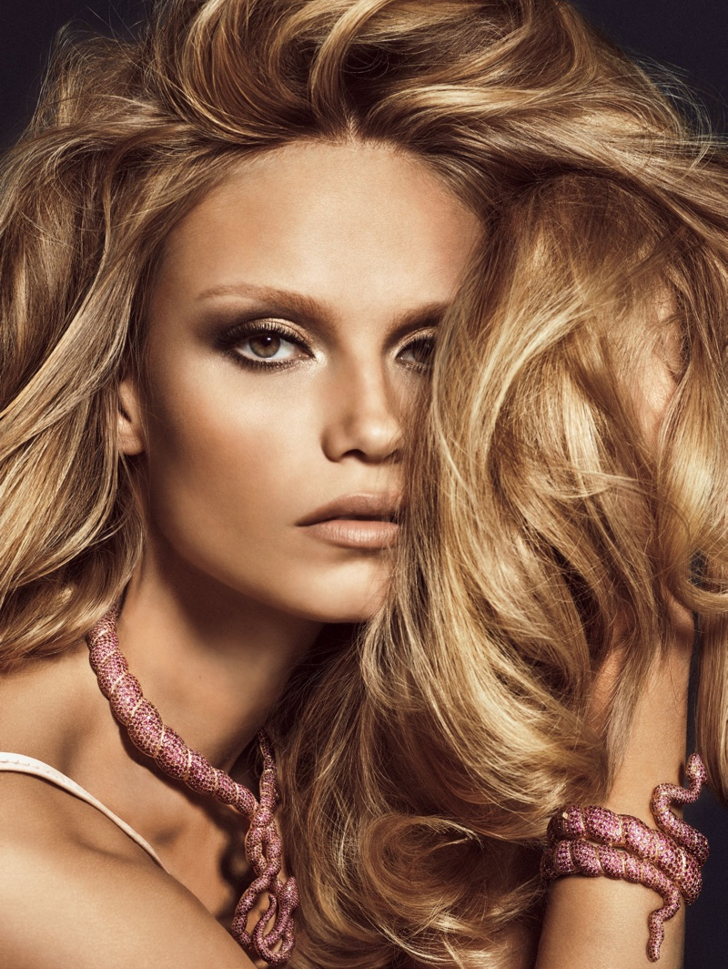 Natasha Poly models her hair in bombshell waves for the editorial