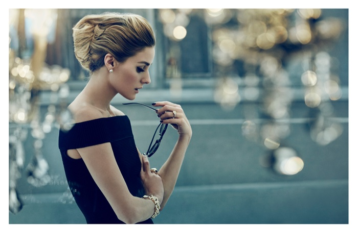 Olivia Palermo poses in a little black dress by Jonathan Simkhai