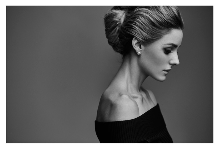 Photographed in black and white, Olivia Palermo wears a bouffant with blonde highlights