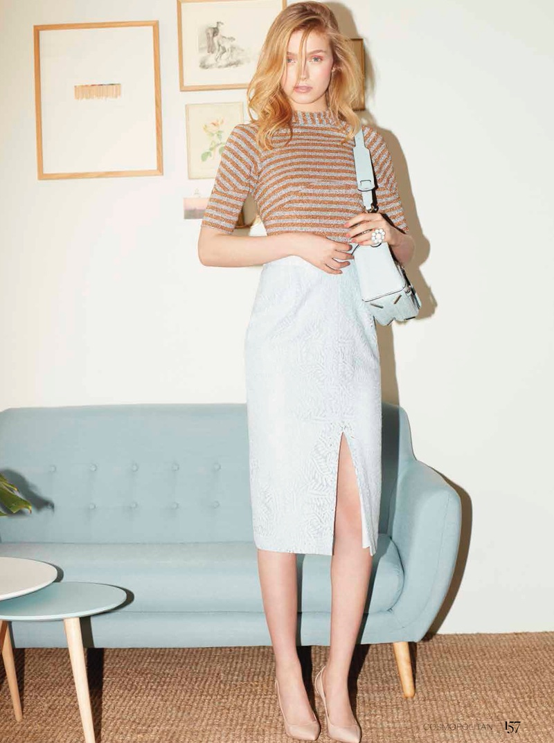 Romy wears striped t-shirt and pencil skirt