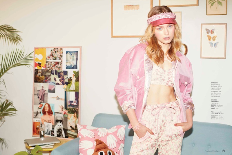 Romy gets sporty in pink wearing a visor hat, bomber jacket, crop top and matching pants