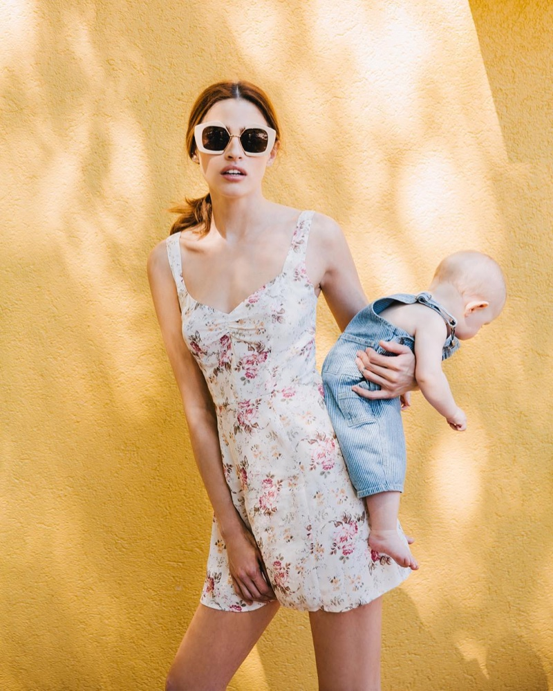 Model Abby Brothers poses for Reformation with her baby daughter