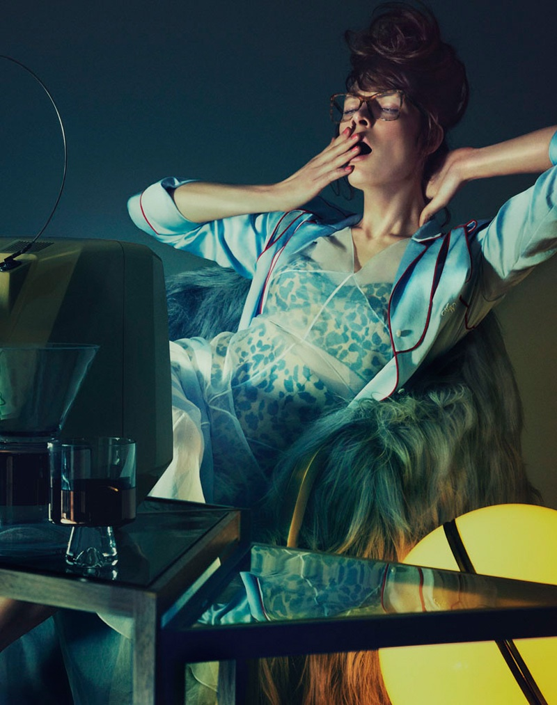 Model lounges in front of television wearing an Alexander Wang pajama top and Dior silk organza dress with Rosamosario Lycra Kate Factor swimsuit