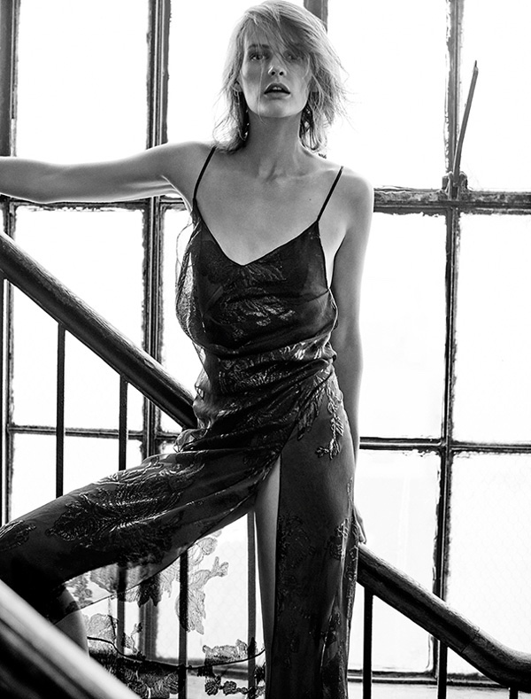Photographed in black and white, Sara models a metallic slip dress designed by Hedi Slimane for Saint Laurent