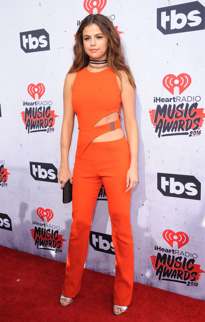APRIL 2016: Selena Gomez attends the 2016 iHeartRadio Music Awards wearing a Mugler jumpsuit with cut-outs. Photo: Tinseltown / Shutterstock.com