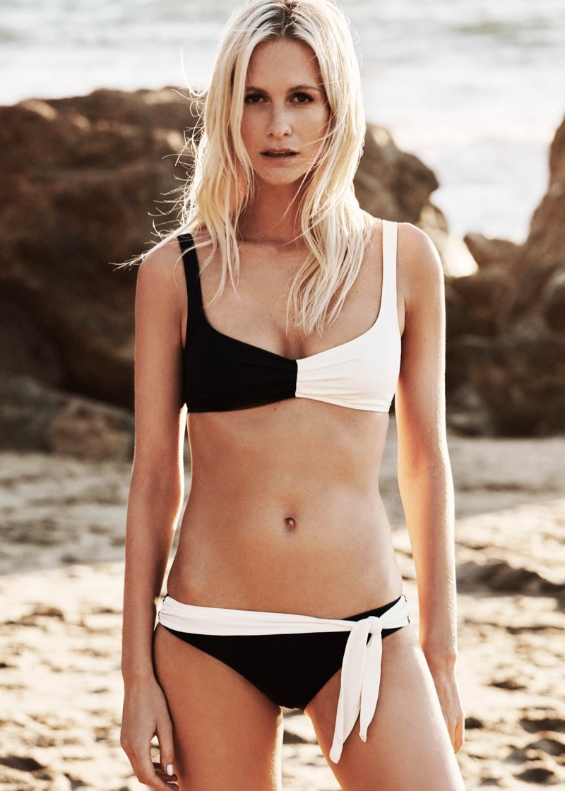 Photographed on the beach, Poppy Delevingne models wrap bikini top from Solid & Striped collaboration