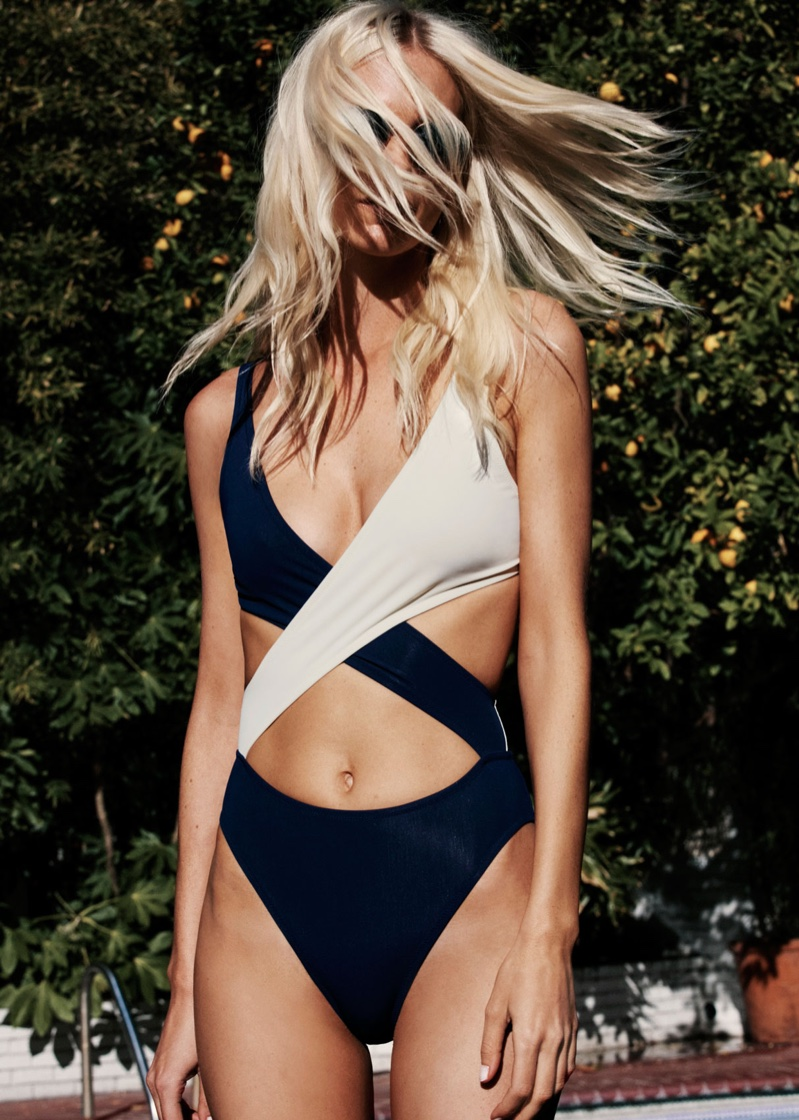 Poppy Delevingne wears the wrap one-piece swimsuit from Solid & Striped