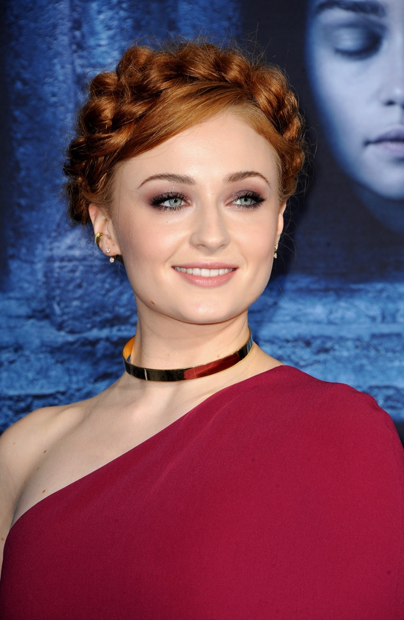 Sophie Turner wears Dutch braids.