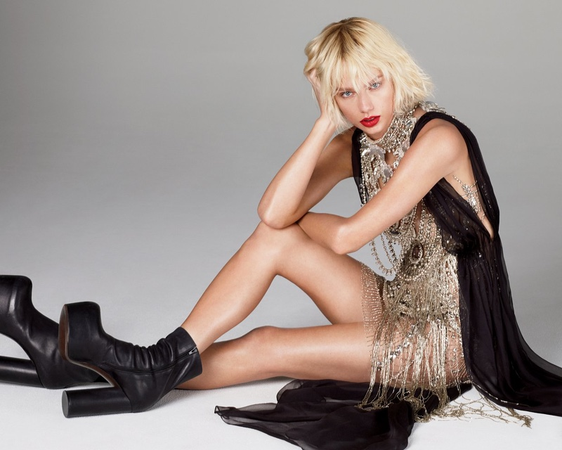 Taylor Swift flaunts her legs in bejeweled Marchesa dress with Vetements boots