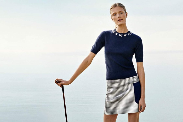Golf anyone? Tory Sport offers short sleeve sweater and print-block skirt