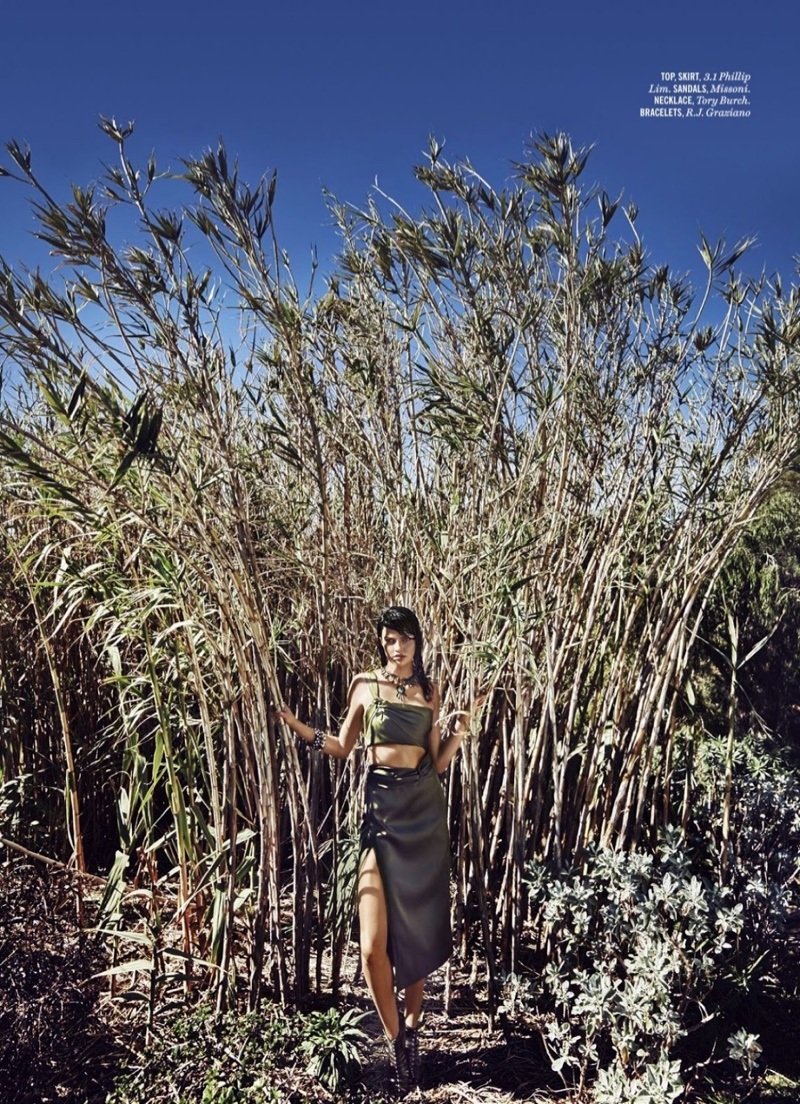 Posing outdoors, Barbara Fialho wears 3.1 Phillip Lim top and skirt with Missoni sandals