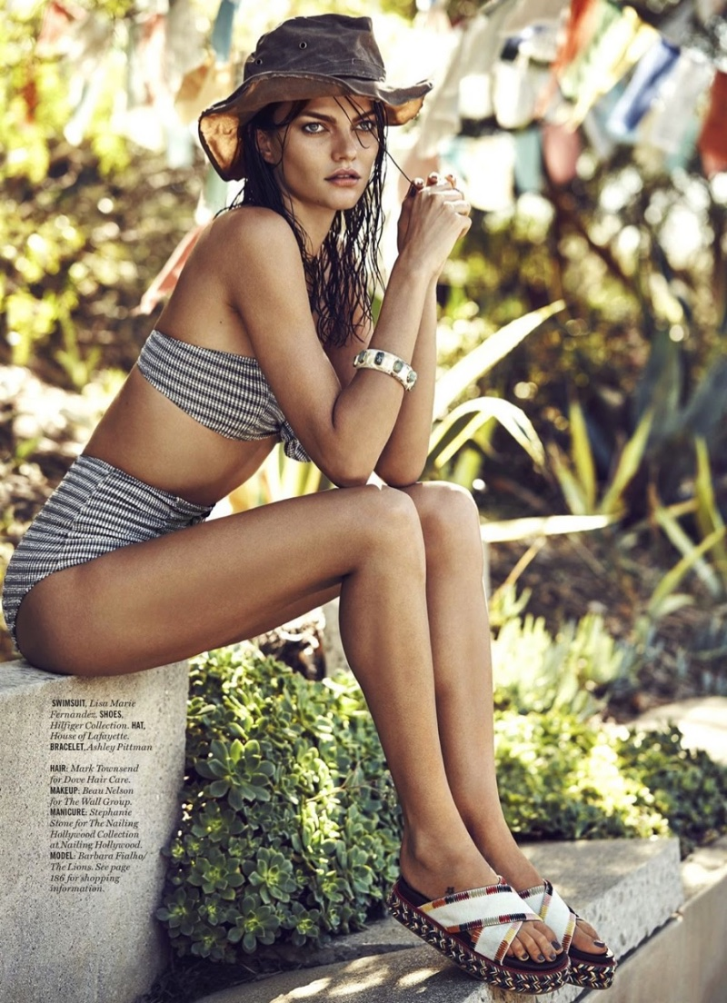 Wearing a wet hairstyle, Barbara sports a Lisa Marie Fernandez bikini with high-waist bottoms and Tommy Hilfiger shoes