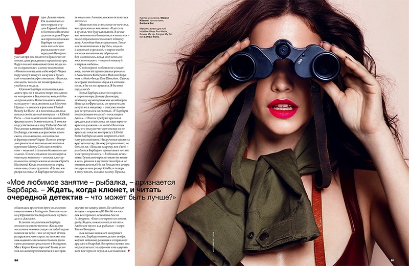 Looking through binoculars, Barbara Palvin amps up the glam with a red lipstick look