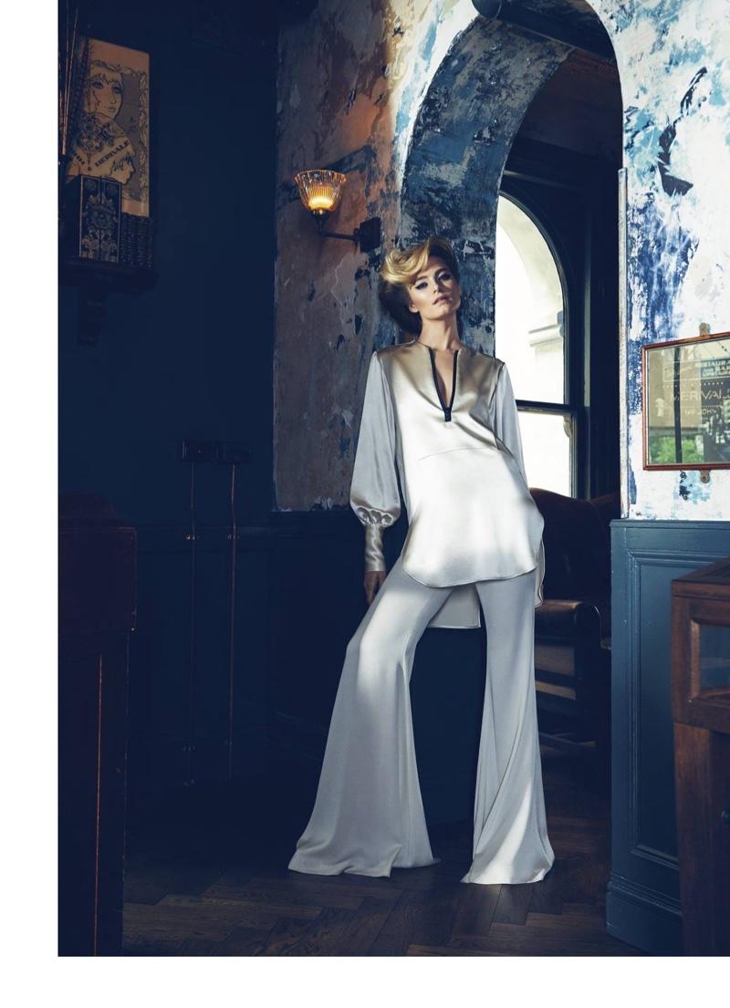 The model poses in lingerie inspired ensembles