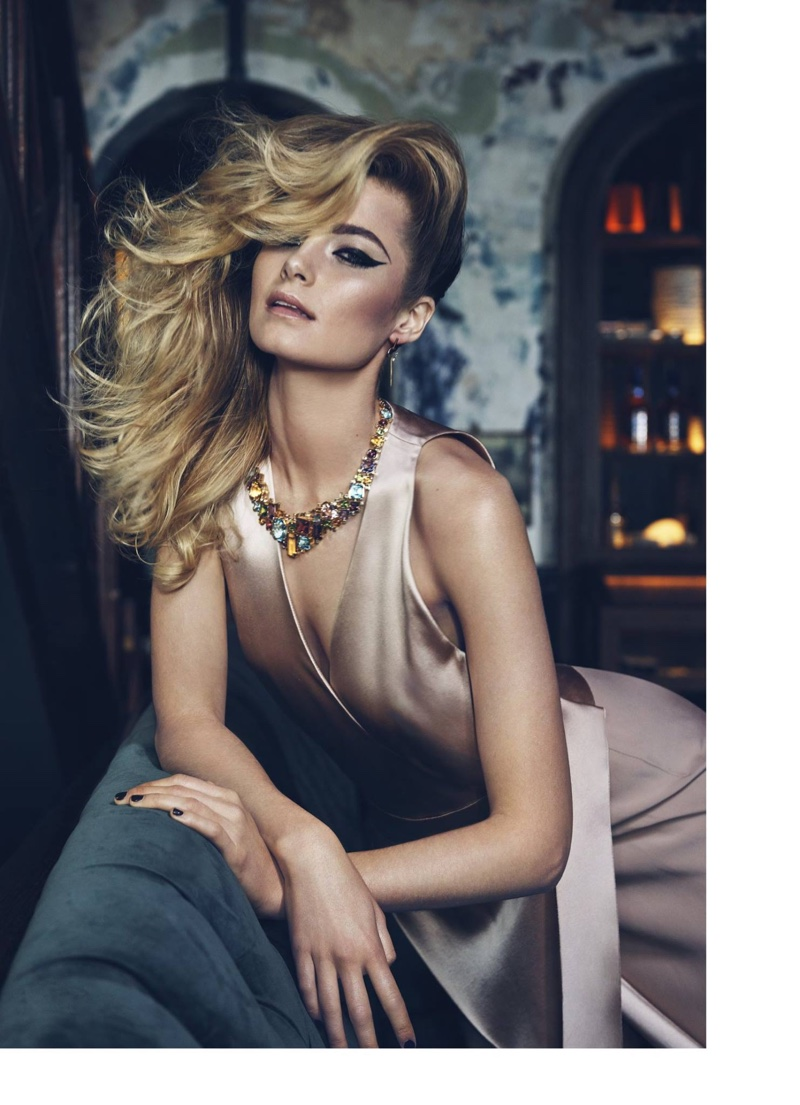 Bridget Malcolm wears a statement necklace and silk dress