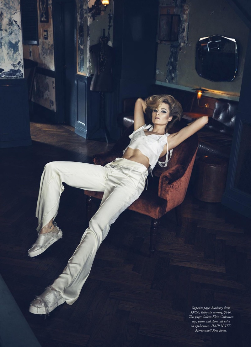 The model sits in a Calvin Klein Collection bra top, trousers and slip-on sneakers