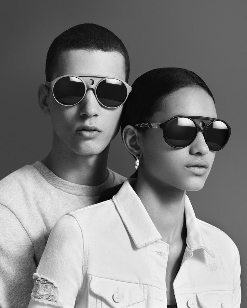 Models wear Calvin Klein sunglasses