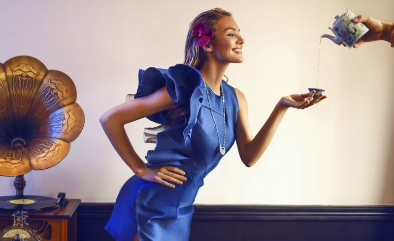 Flashing a smile, Candice models a blue Lanvin dress with ruffle embellishment
