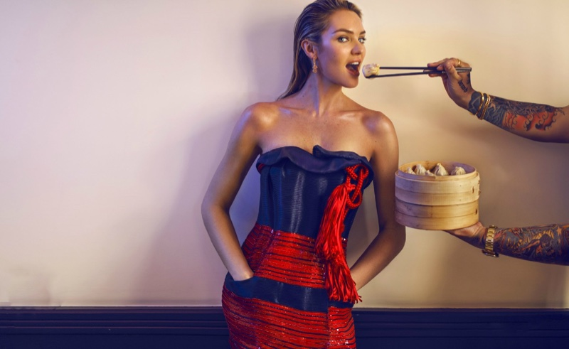 Getting ready to take a bit of dim sum, Candice Swanepoel poses in a strapless red dress for this image