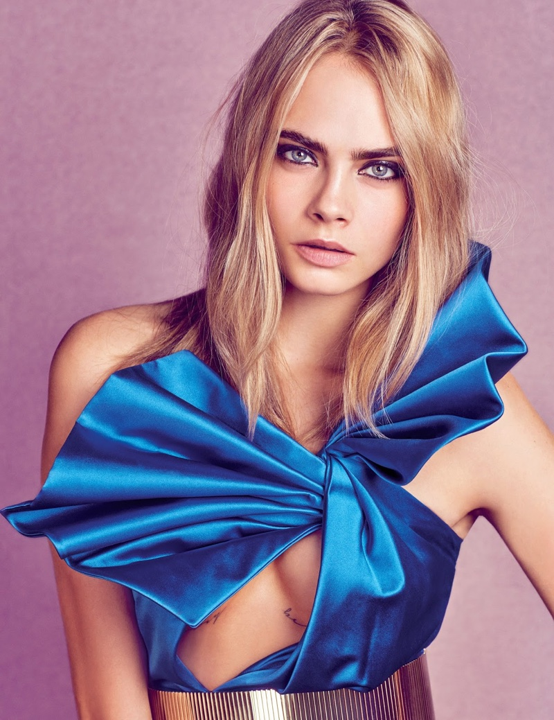 Cara Delevingne wears Saint Laurent top and belt