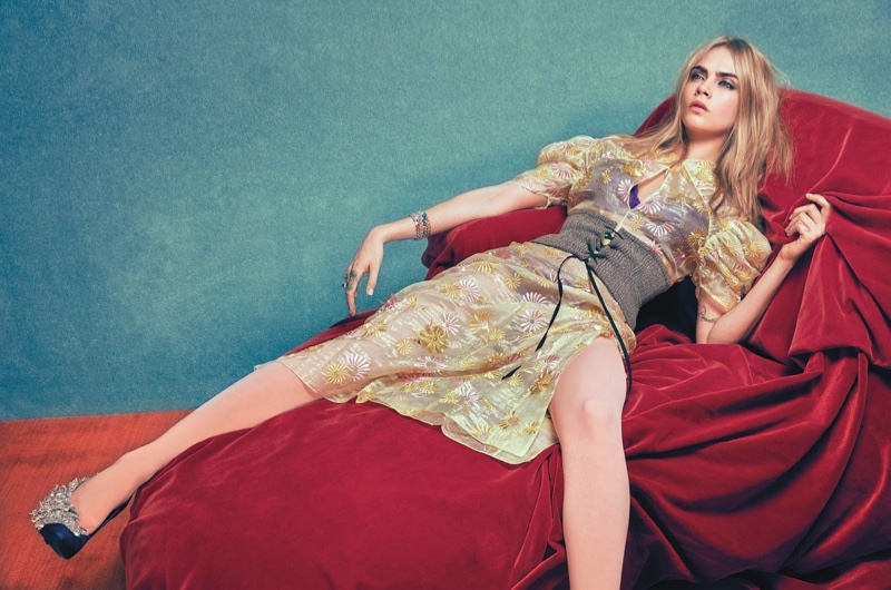 Cara Delevingne poses in Prada dress and corset with Balenciaga pumps