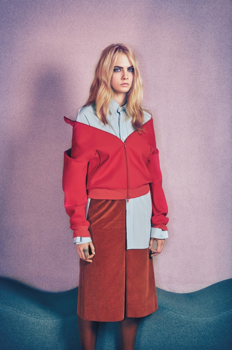 Cara poses in Balenciaga jacket, shirt and skirt