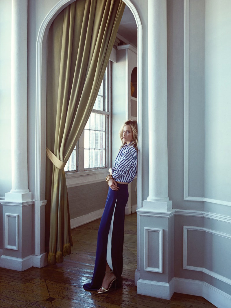 Carolyn Murphy serves nautical vibes with a striped shirt and palazzo pants from Ralph Lauren