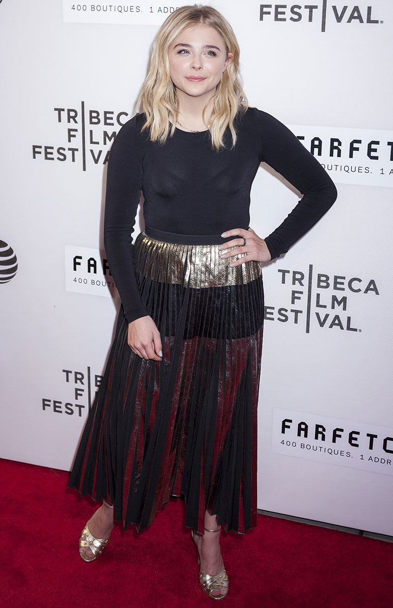 APRIL 2016: Chloe Grace Moretz attends the 2016 Tribeca Film Festival wearing a long-sleeve top with pleated skirt. Photo: Sam Aronov / Shutterstock.com