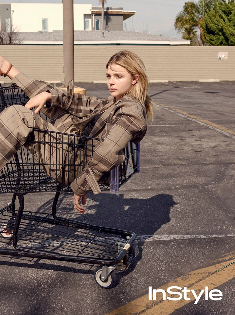 Chloe Grace Moretz poses in a shopping cart