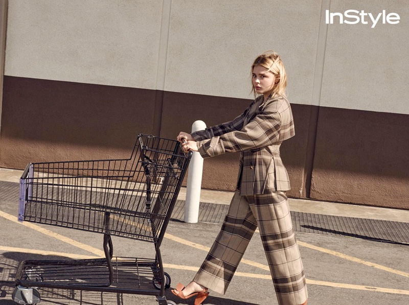 Pushing a shopping cart, Chloe Grace Moretz wears plaid Celine jacket and trousers