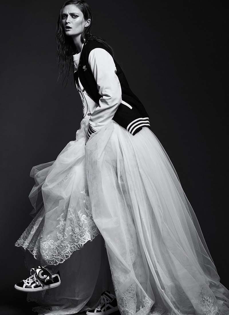 Photographed by Chris Nicholls, the model poses in maxi dresses and skirts