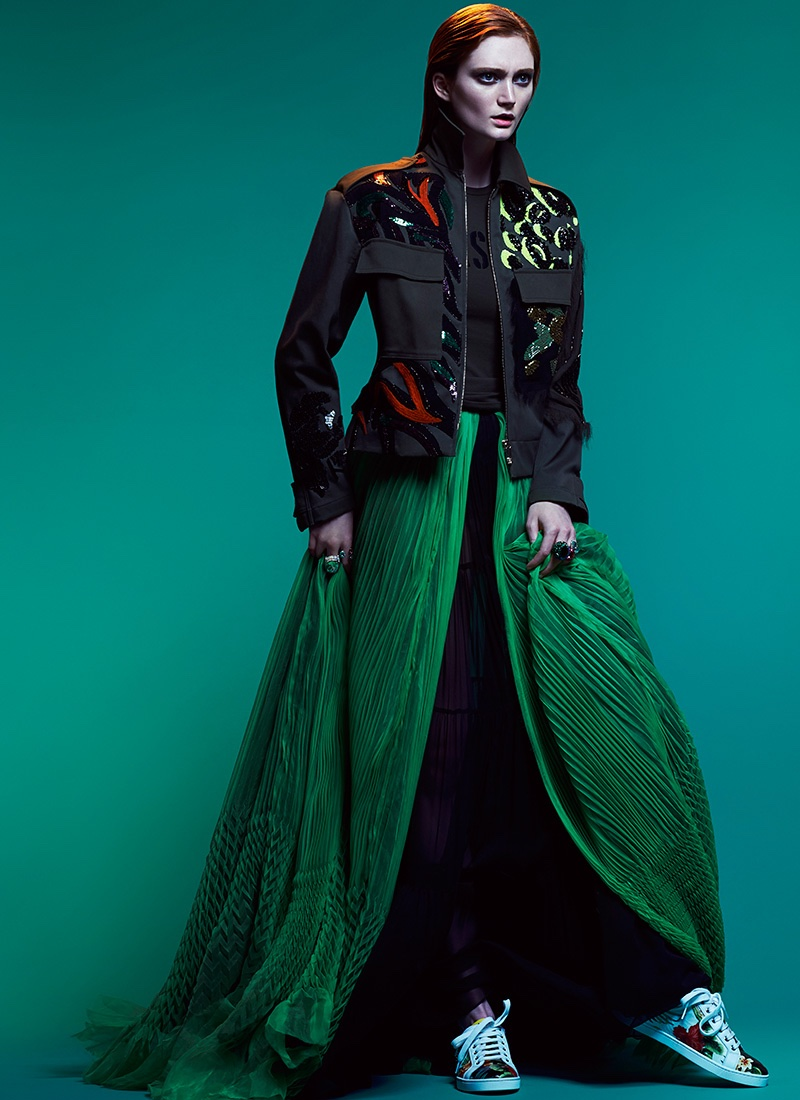 The model looks sporty glam in Versace jacket and top with green skirt from DSquared2 and Christian Louboutin sneakers