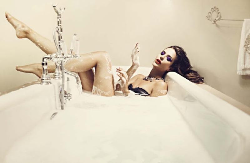 Clara Alonso wears Zana Bayne bustier while lounging in a tub