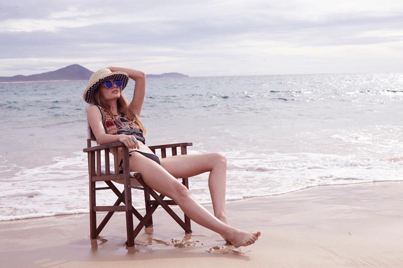 Model wears Cleobella Joni crochet bikini top