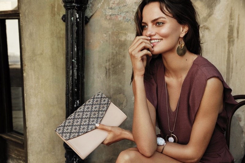 Barbara Fialho is all smiles with a clutch for Dynamite's summer 2016 collection