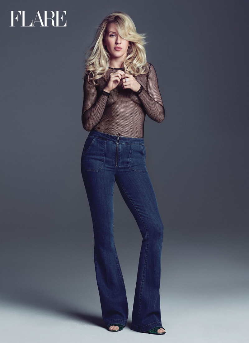 Ellie Goulding wears a sheer shirt from Max Mara with Paige Jeans