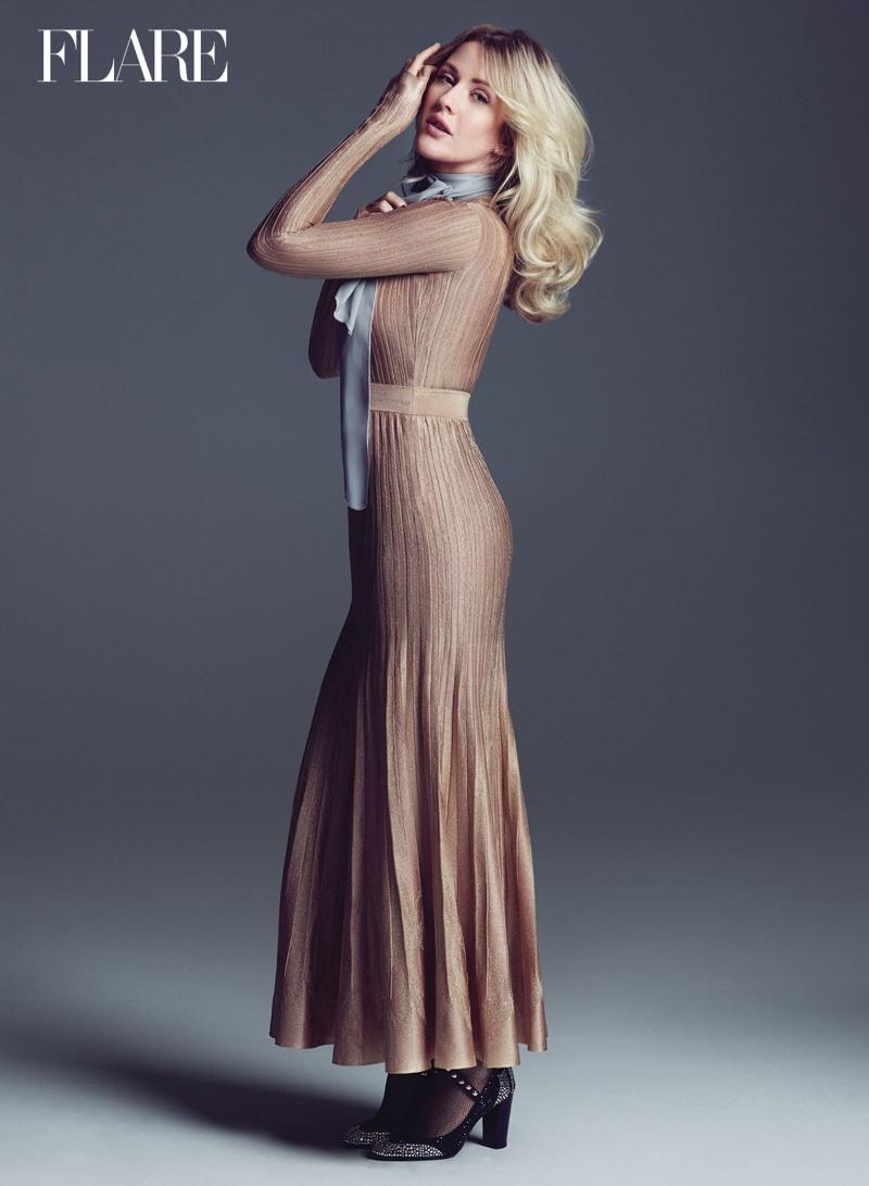 Singer Ellie Goulding wears a long sleeve Chanel dress with pleats
