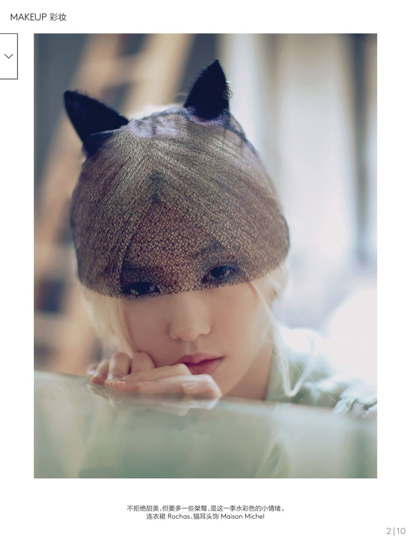 The blonde model poses in cat ears for the fashion feature
