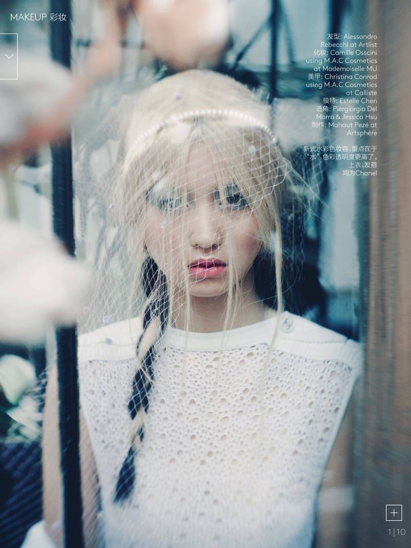 The model wears a long braid in the feature