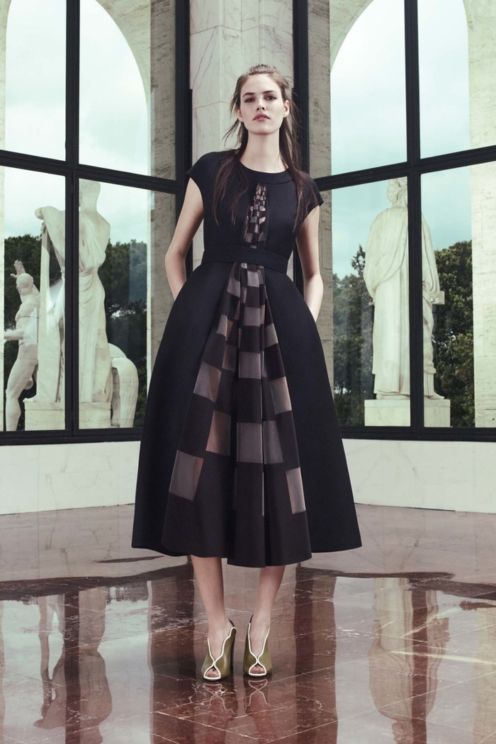 A look from Fendi's resort 2017 collection featuring a black dress with checkered details