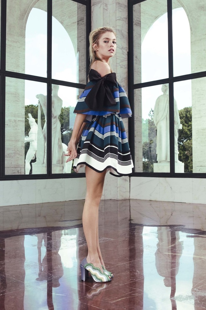 A look from Fendi's resort 2017 collection featuring an off-the-shoulder top and striped miniskirt