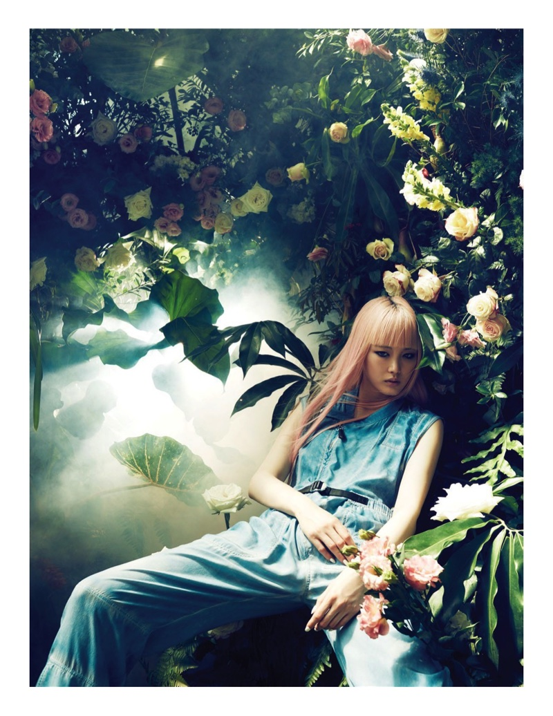 Model Fernanda Ly poses against a backdrop of floral blooms