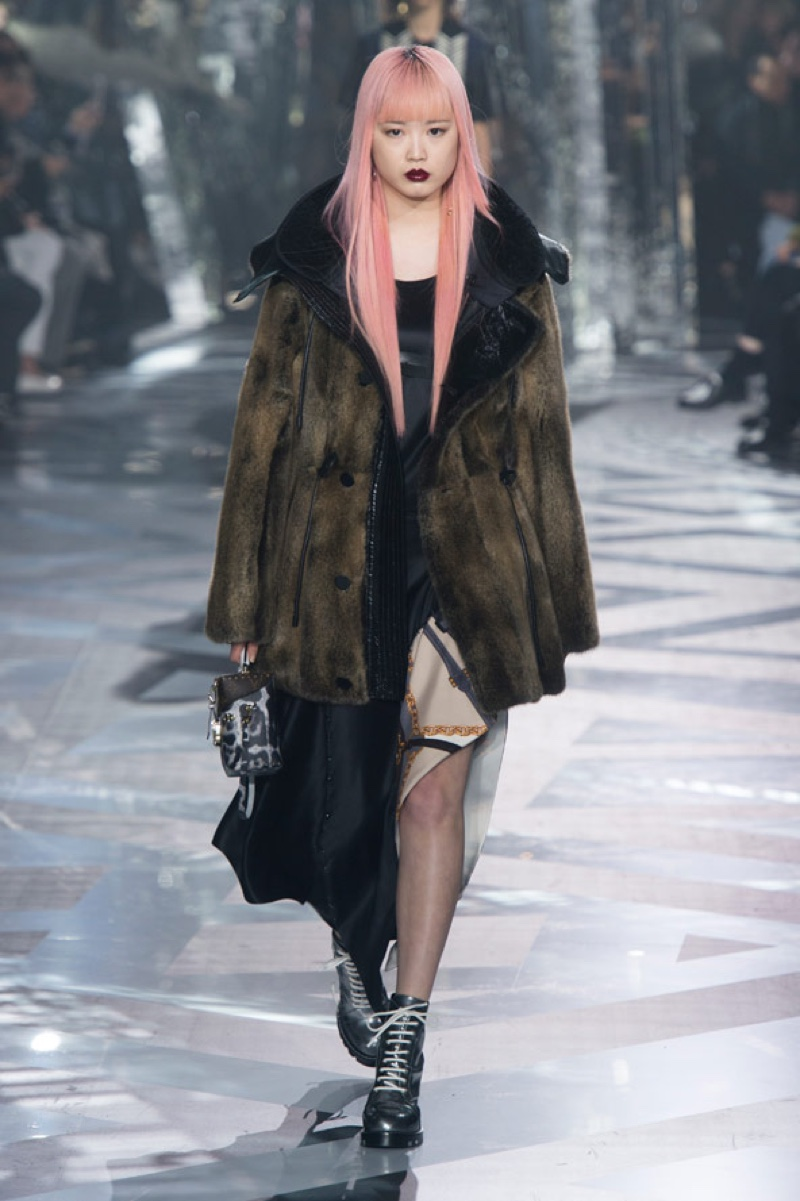 MARCH 2016: Fernanda Ly walks the runway at Louis Vuitton's fall-winter 2016 show during Paris Fashion Week