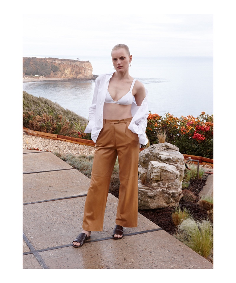 Guinevere van Seenus wears white shirt, bra top and trouser pants