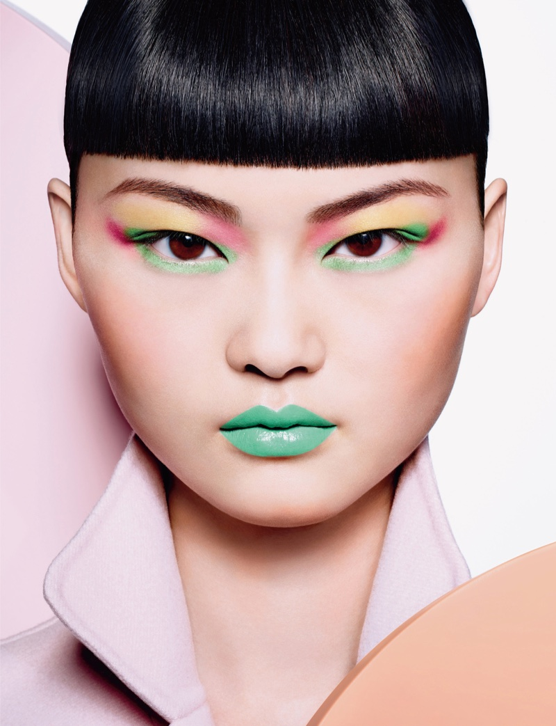 The Chinese model wears bold, pop art inspired makeup looks in the editorial