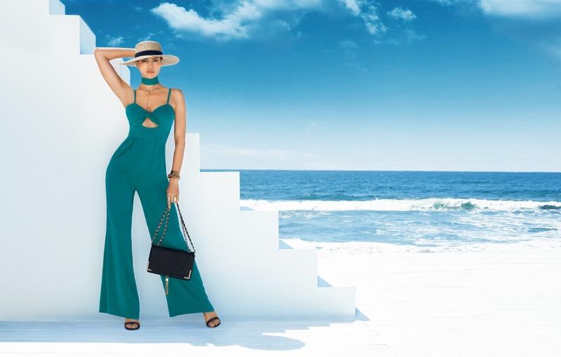 Irina Shayk flaunts her curves in teal Bebe jumpsuit