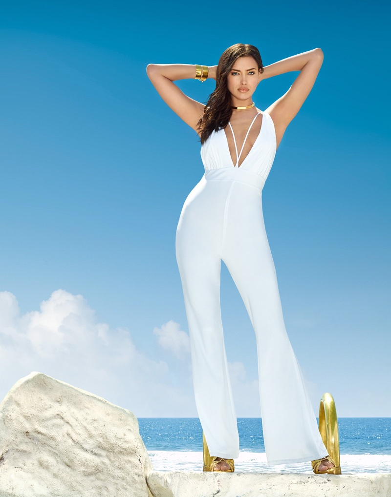 Irina Shayk wears a white jumpsuit from Bebe's summer 2016 collection